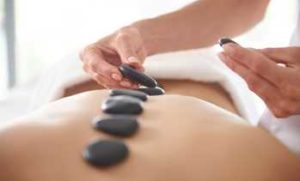Our Masseuses Specialize in Hot Stone Massage